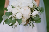 a lush white wedding bouquet with peonies, roses and some foliage is an elegant idea
