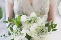 white roses, hydrangeas, smaller blooms and greenery for an elegant and beautiful bridal bouquet