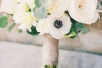 a white peony and anemone wedding bouquet with a twine wrap is a stylish idea with a touch of whimsy