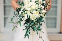 a cascading white wedding bouquet with plenty of foliage looks very refined and chic