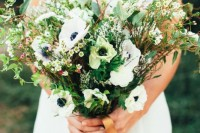 a wedding bouquet with lots of greenery and foliage for a texture and some white anemones