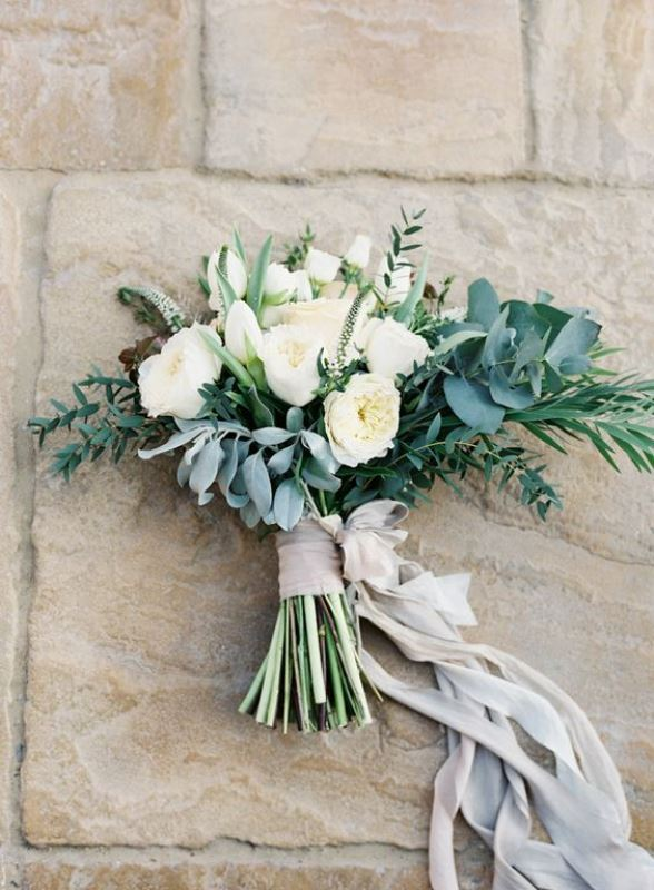 white peonies, pale and usual greenery and neutral ribbons for an airy and breezy wedding bouquet