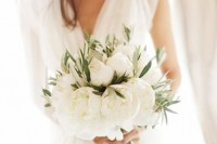 a lush white peony wedding bouquet with greenery is a great idea for a summer bride
