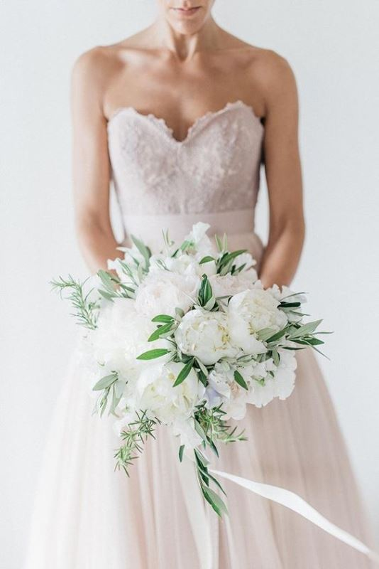 a beautiful and breeze white peony wedding bouquet with various types of greenery is always a gorgeous idea