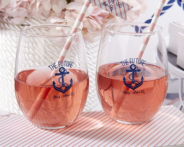 simple glasses with nautical decor and striped straws that match the drinks