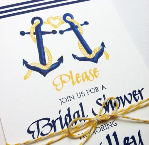 a bright navy and yellow invitation with anchors is a cool idea for a nautical bridal shower
