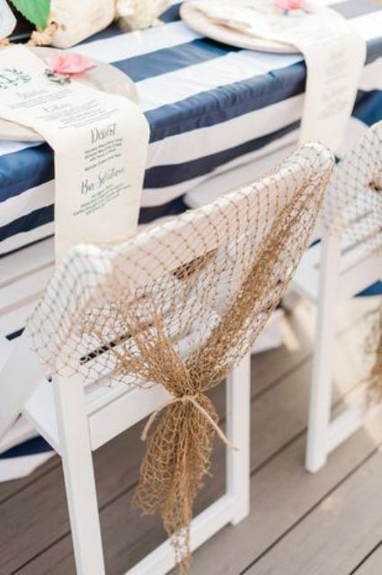 cover the table with a striped tablecloth and your chairs with fishing net for a nautical bridal shower