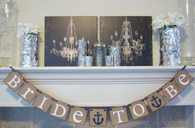 a burlap banner with themed words is a cool and simple decoration for your nautical shower