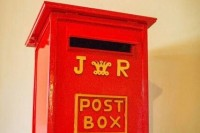a vintage red and gold mailbox is a cool and stylish idea, add your monograms and go ahead