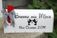 a white mailbox with a little flag, the names and Mickey and Minnie for a Disney themed wedding