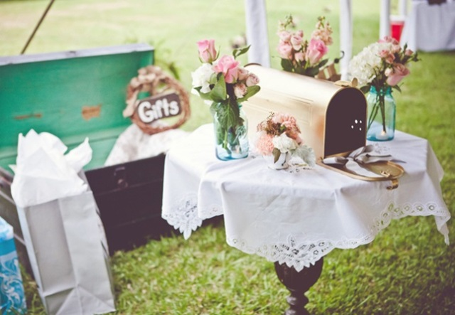 a simple mailbox with blooms around in the jars is a cool idea for a rustic wedding