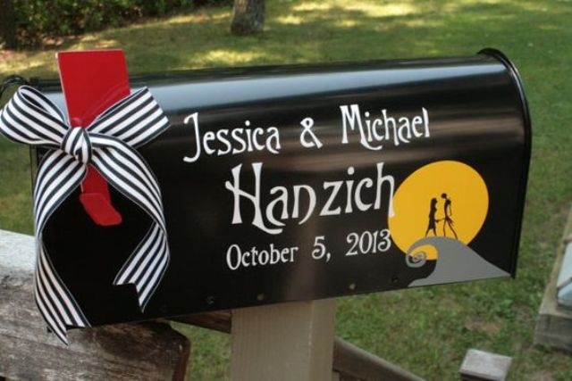 a black mailbox with the names and a little flag for a Nightmare Before Christmas wedding