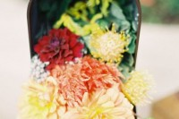 use a mailbox as a wedding decoration with bright blooms and greenery for an effortless and chic look