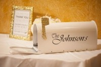 a white mailbox with a gold glitter flag and the name of the couple is a chic and stylish idea