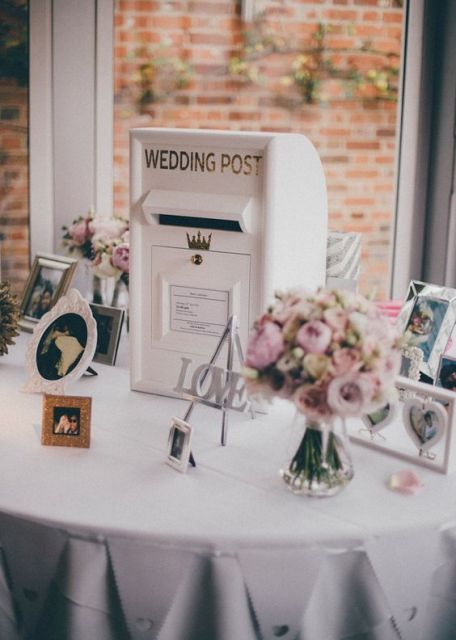 a vintage white wedding mailbox surrounded with your couple's photos and pastel blooms in jars