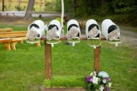 a row of white mailboxes used to display programs of the wedding is a cool and creative idea