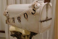 a neutral shabby chic mailbox decorated with a bunting and fabric blooms plus pearls is a very cool idea