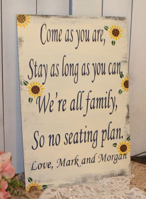a cozy rustic sign with sunflowers is a cool idea for any rustic wedding, very inspiring