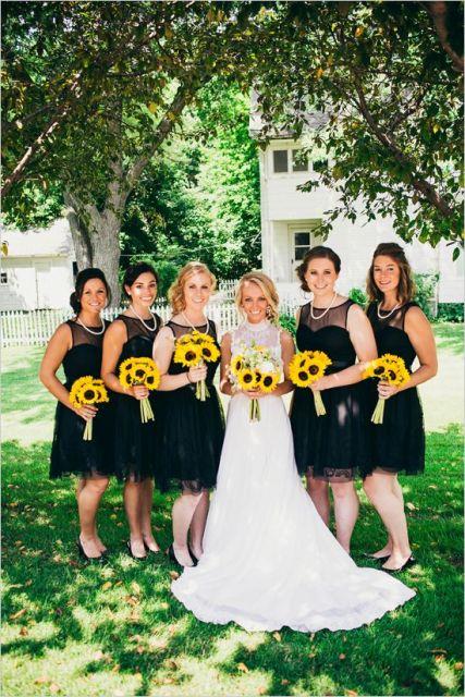 sunflower bouquets are adding a bright spot to your monochromatic wedding attire