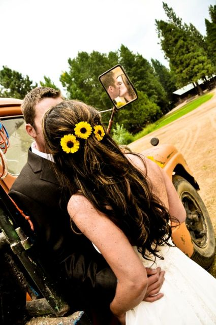 accent your wedding hairstyle with pretty sunflowers to make it look bright and very cozy