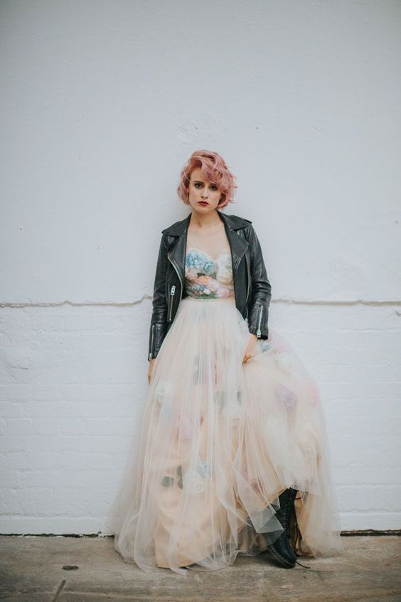 a badass bridal look with a whimsical floral strapless wedding dress, combat boots and a black leather jacket plus pink hair