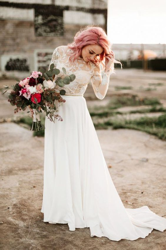 a beautiful and chic bridal look with a lace applique top and a plain skirt and pink wavy hair is very romantic