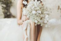a beautiful baby's breath and lunaria wedding bouquet for an airy feel and a unique look