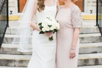 a blush maxi dress with sequined short sleeves and a high neckline for a glam feel