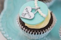 a breakfast at Tiffany themed cupcake with ivory, tiffany blue and silver icing