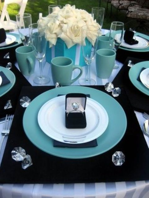 a breakfast at Tiffany's bridal shower setting in blue, black and white, with white roses and diamonds