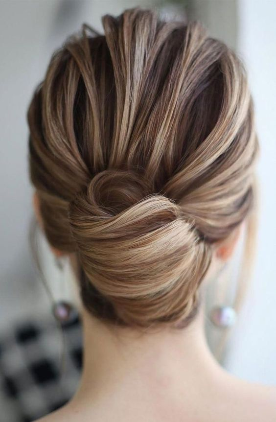 a chic and elegant French twist updo with a voluminous top and an elegant knot will fit medium length hair, too