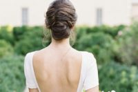 a chic and voluminous French twisted chignon with textural hair and some locks down