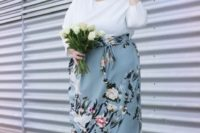 a chic knee gown with a white bodice with long sleeves and a light blue floral skirt, light blue shoes