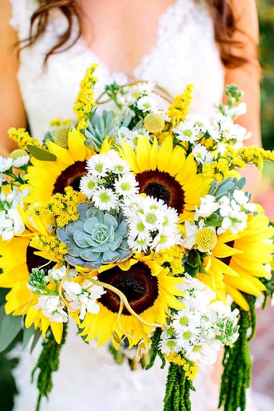 a colorful wedding bouquet of sunflowers, white blooms, succulents and some cascading greenery