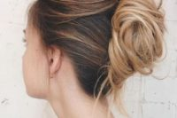 a messy and chic French twist chignon with a messy and layered top and a messy low bun