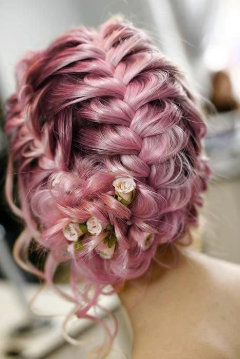 a pink braided wedding updo with some fresh garden roses and waves down for a pciture-perfect look