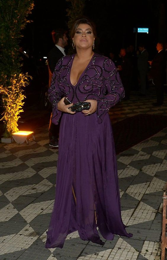 a purple maxi dress with slits, an embellished and embroidered bodice with a deep V-neckline and long sleeves