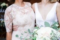 a sheath midi dress with a lace embellished bodice, a high neckline, short sleeves and a plain skirt
