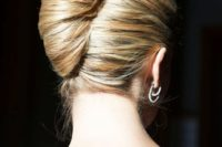 a sleek and super tight French twist idea is ideal for a formal wedding