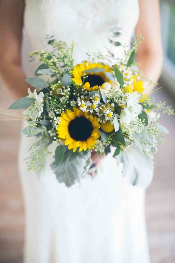 a stylish wedding bouquet of white blooms, sunflowers and textural greenery for a spring or summer bride