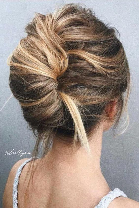 a super messy and bold French twist updo with a messy volume on top and enough mess in the twist