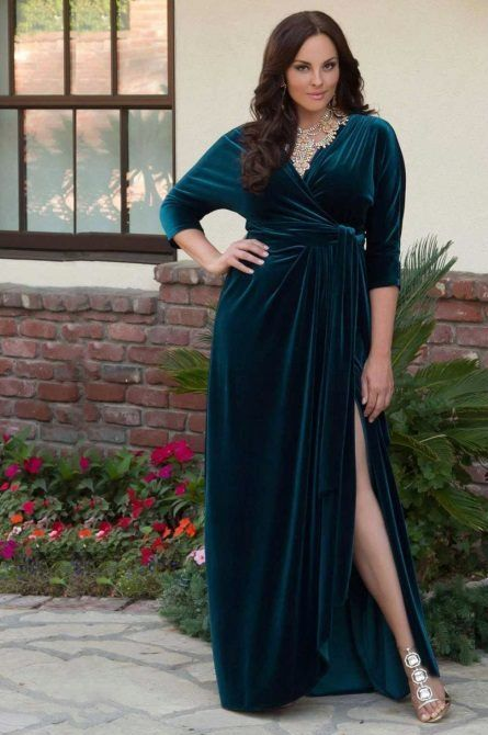 a teal velvet wrap maxi dress with a draped skirt and long sleeves plus a statement necklace and heels
