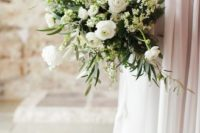 a textural wedding bouquet in white and green with an interesting those who love simplicity and classics