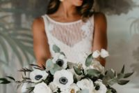 a white anemone wedding bouquet with greenery of various kinds is a chic and bold idea