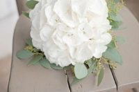 a white hydrangeas wedding bouquet with eucalyptus is a chic rustic idea for a bride