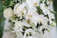 a white orchid and rose wedding bouquet with textural greenery is a chic idea for a modenr bride