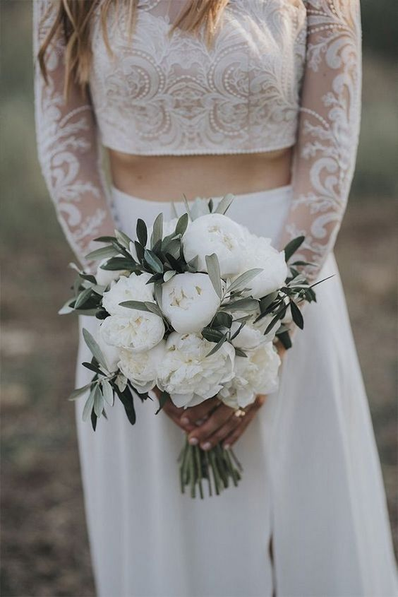 a white peony and olive greenery wedding bouquet is classics with a frehs and modern twist