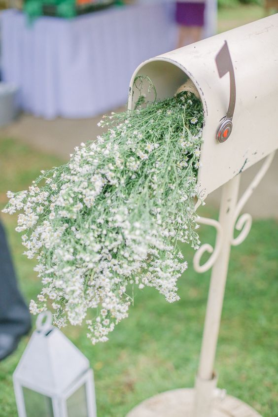 a whitewashed mailbox with fresh wildflowers will be a nice decoration for a summer boho wedding