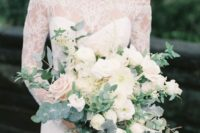 an elegant white bloom wedding bouquet with pale greenery and grey ribbons plus much dimension