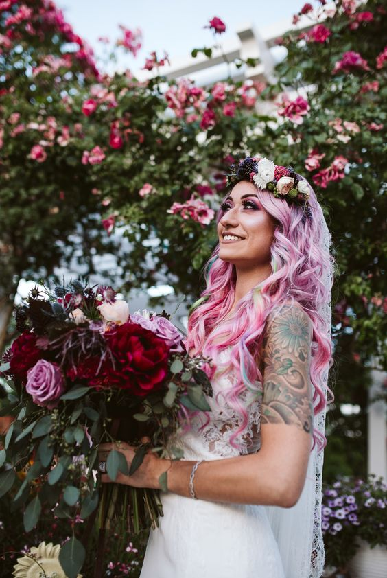 blue and bubble gum pink wavy hair down plus a bold floral crown for a colorful and statement bridal look